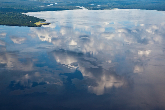 daniel beltra photo of clouds reflecting in water