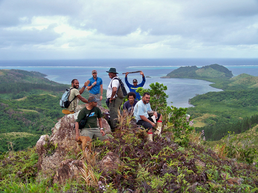 people standing on top of a hillside in fiji