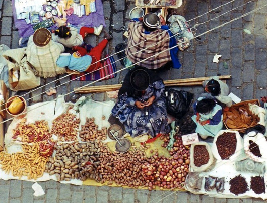 view of market trader in the andes with huge collcetion of potatoes
