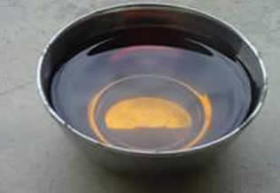 bowl containing dark coloured liquid