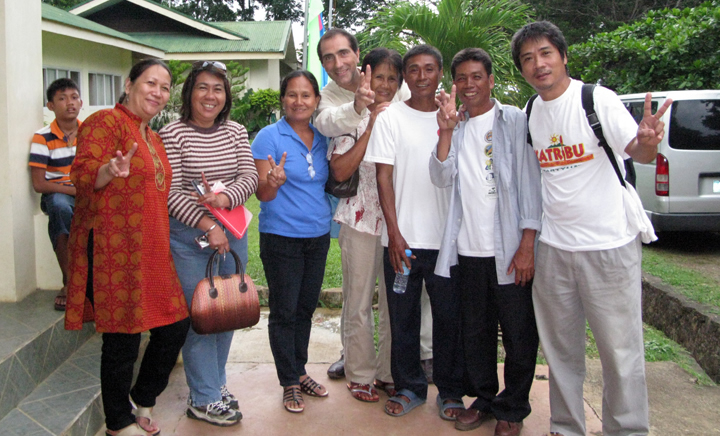 Picture of happy people celebrating the latest news on the mining debate in Palawan